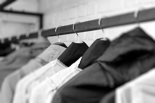 clothes on racks in store